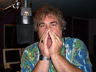 "Randy Crenshaw Photo Gallery Caption Contest #1 ""Randy AGAIN spreading swine flu by forgetting to sneeze into his sleeve... never mind, he doesn't have any! Do you know where your microphone's been?"""