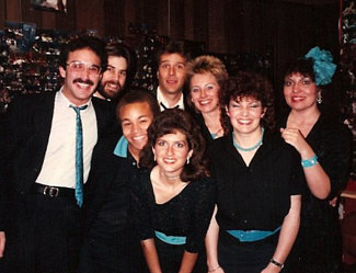 Here's Eight To The Bar, posing before a live gig, circa 1985; probably at Fellini's, a great little Italian restaurant and club on Melrose in L.A. which has, sadly, been gone for many years. We used to cram all eight of us onto their tiny little stage and sing, with our sole pay being a meal provided by Fellini's (not a bad deal when you're a starving young singer!)... Personnel, L to R: Gary Rosen, Randy Crenshaw, Stewart Wilson-Turner, Bill New, Robin Ehlers, Barbara Bentree, Jan Roper, Pam Austin.