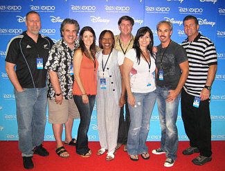 "Here we are, standing in front of the ""celebrities"" photo wall at the Anaheim Convention Center, taking a break in rehearsals for the first annual Disney fan appreciation event, entitled ""D23 Expo"". Singer personnel (L to R): Greg Whipple, RC, Beverley Staunton, Clydene Jackson, Gordon Goodwin (music conductor and arranger), Sandie Hall Brooks, Rick Logan (fearless vocal contractor / leader), and Dan Savant (trumpet player / king of payroll)."