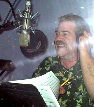 This is a snapshot of Randy Crenshaw on the mic in 2008 at Nelson Kole's home studio in Woodland Hills, singing for a Princess Cruises industrial session, taken by the fearless engineer, Les Brockmann. As always, RC is impeccably dressed in shorts, flip-flops, and an aloha shirt...
