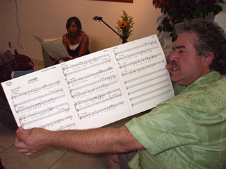 "At L.A. Sound Gallery, August 2009, Randy perusing chart for ""Monty Burns Blues,"" part of an upcoming ""The Simpsons"" episode (with session singing legend, Maxine Waters in the background)."