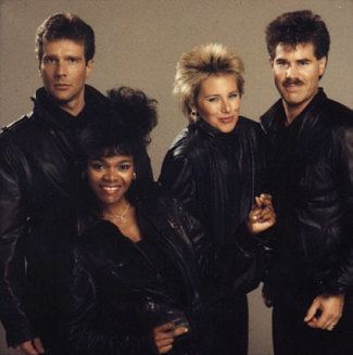 Here is the ultra-glamorous Terra Nova fashion photo shoot, a few months later, when we were trying to put together a Terra Nova press kit. Now we definitely look like a West Hollywood motorcycle gang! Watch out, music world... Personnel, left to right: Bill New, bass; Gale Johnson, soprano; Barbara Bentree, alto; Randy Crenshaw, tenor (and apparent Freddie Mercury wanna-be)...